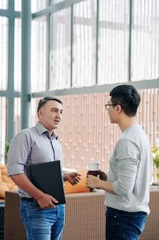 Entrepreneur talking to young employee