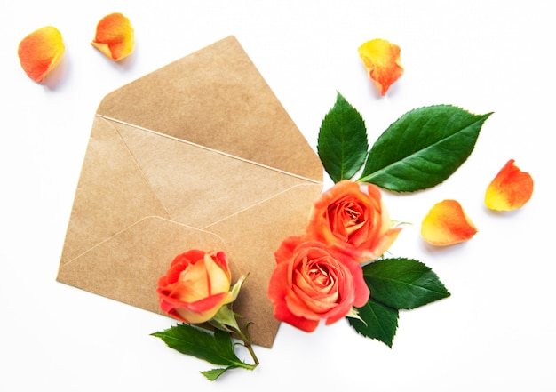 Envelop with roses on a white background