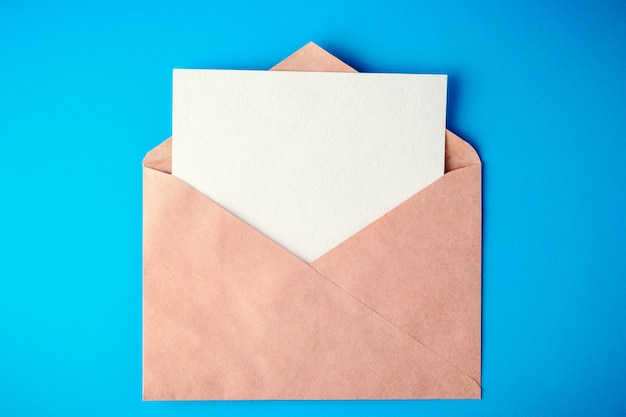 Envelope on blue background with shadows