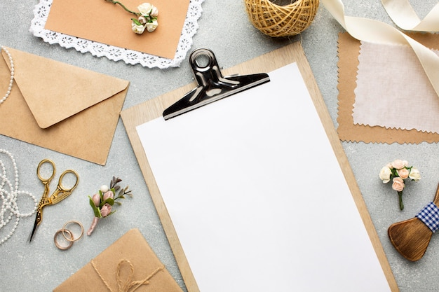 Envelope and clipboard copy space wedding beauty concept