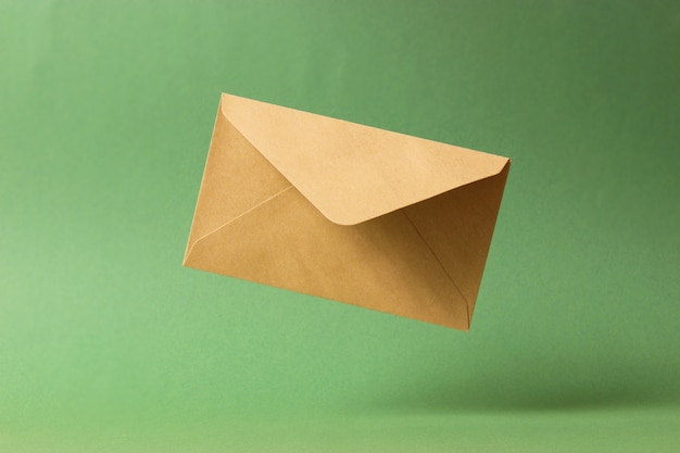 The envelope falls to the ground on a colored background