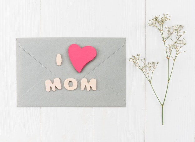 Envelope for mother`s day with branch gypsophila