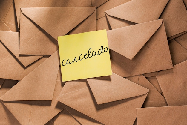 Envelope pack with postponed message on table