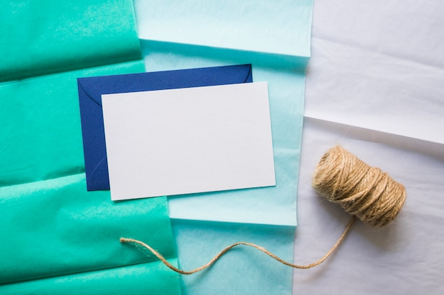 Envelope and tape on gradient paper line