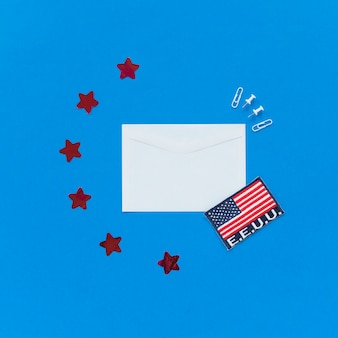 Envelope and usa flag on blue background