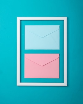 Envelope in a white frame on blue surface