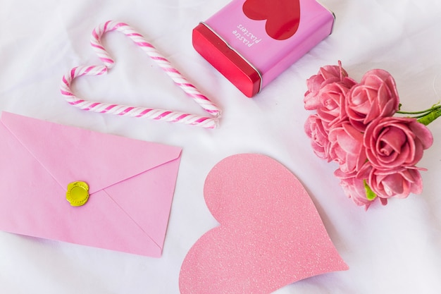 Envelope with big paper heart on table