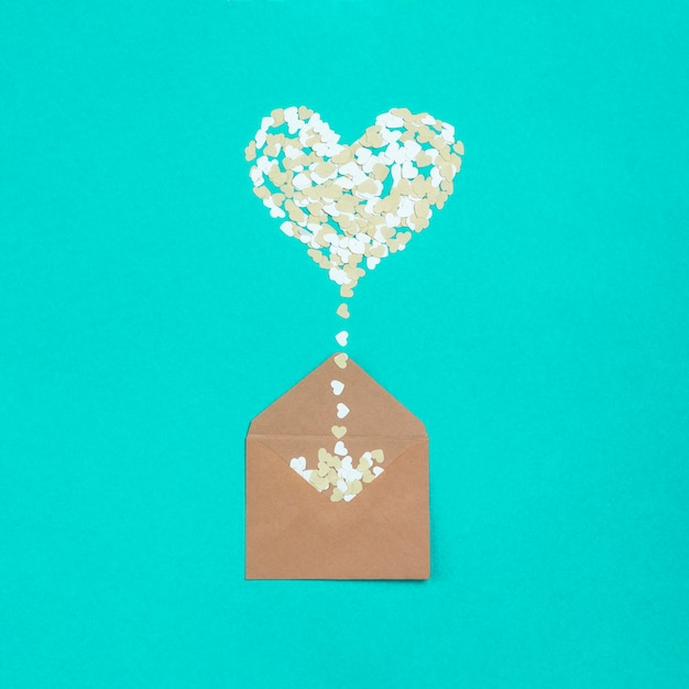 Envelope with heart shape of papers