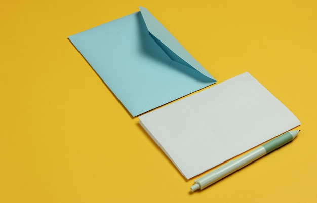 Envelope with a letter and pen on yellow background. valentine's day, wedding or birthday.