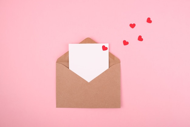 Envelope with a love letter on a pink background. valentine's day concept. copy space.