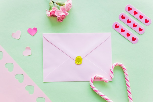 Envelope with paper hearts on table