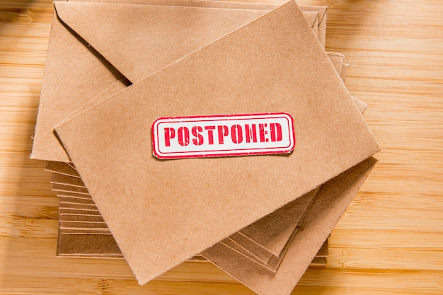 Envelope with postponed message