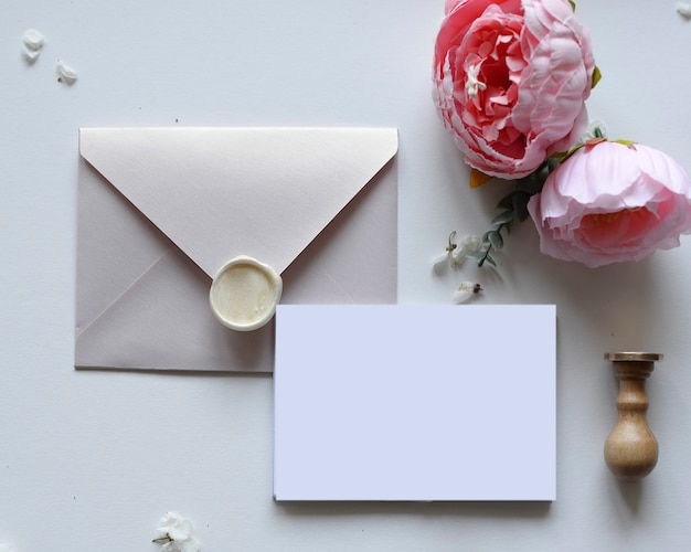 Envelope with wax, letter and flowers