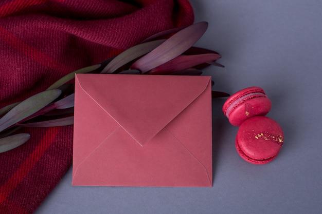 Envelopes burgundy color and flower on gray