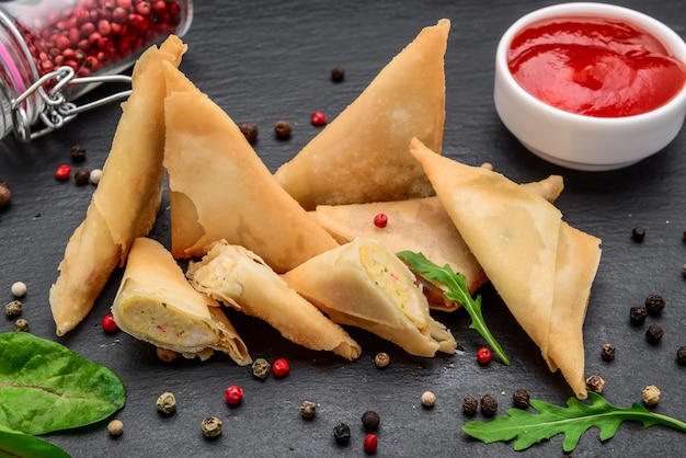 Envelopes of dough with toppings and spicy sauce. asian cuisine