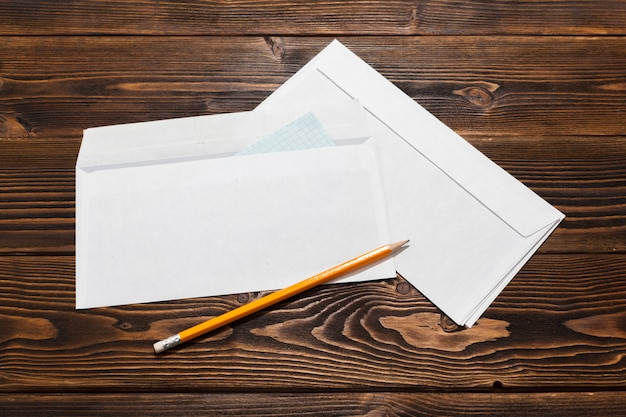 Envelopes on wooden table