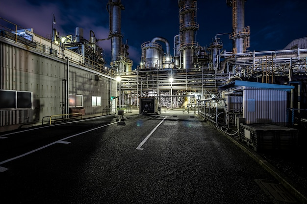 Environmental pollution and factory exterior at night