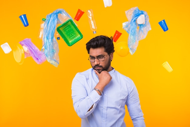 Environmental pollution, plastic recycling problem and ecology problem concept - pensive indian man