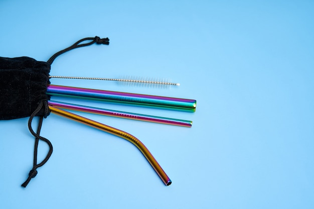 Environmental trend reusable metal beverage straws kit with cleaning tool in transportation bag.