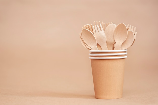 Environmentally friendly disposable tableware wooden spoons and forks in paper cups