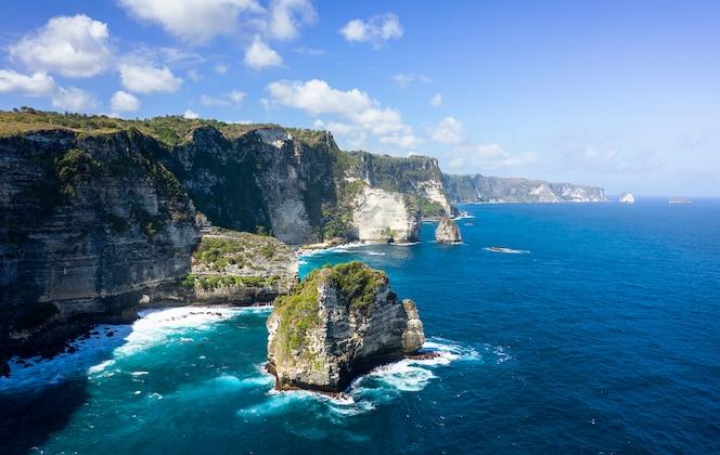 epic drone shot of banah cliff at nusa penida, bali - indonesia