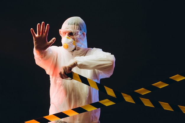 Epidemiologist on protective clothes on restricted area