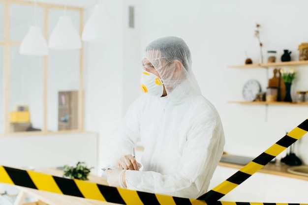 Epidemiologist on protective clothes at restricted area
