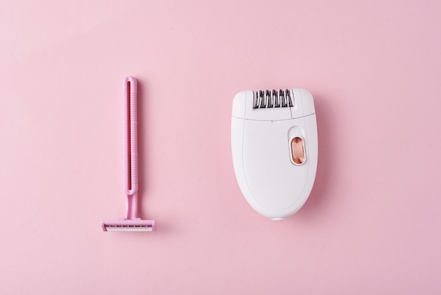 Epilator and razor fr shaving on pink background