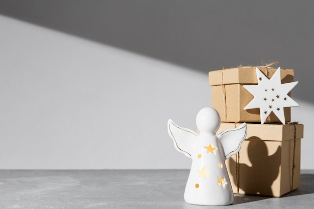 Epiphany day angel figurine with gift boxes and copy space