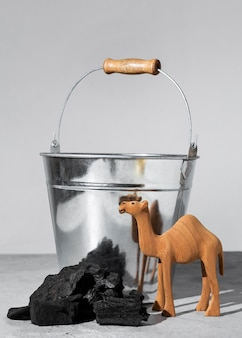 Epiphany day camel figurine with coal and bucket