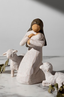 Epiphany day female figurine with newborn and sheep