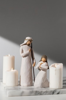 Epiphany day female and male figurine with newborn and candles