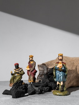 Epiphany day kings figurines with sack of coal and copy space