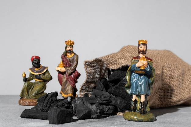 Epiphany day kings figurines with sack of coal