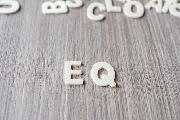 Eq word of wooden alphabet letters. business and idea concept