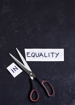 Equality and inequality concept on black background
