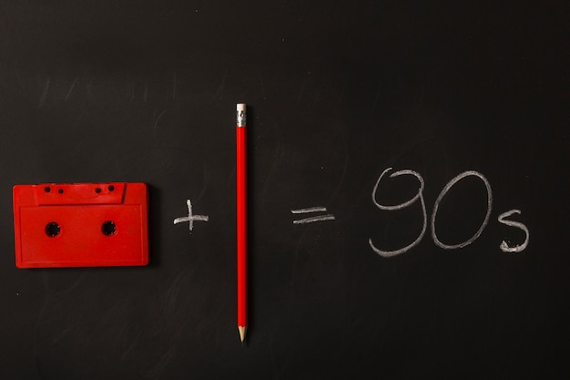 Equation made with cassette tape and pencil on blackboard
