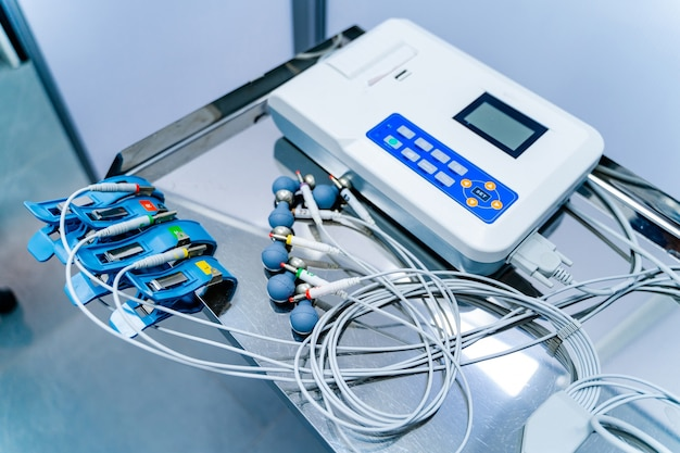 Equipment for electrocardiogram in clinic. cardiology and medicine concept. ecg in clinic. medical issues.