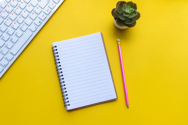 Equipment and empty notebook with on yellow