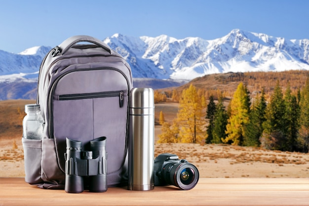 Equipment for hiking in mountains . backpack with tourist equipment.