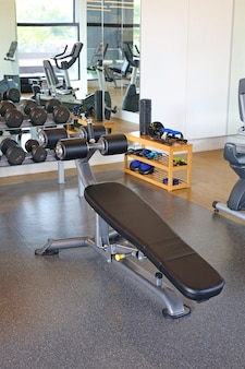 Equipment at modern gym room fitness center