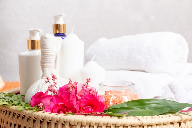 Equipment in spa room such as white candle, cream , towel