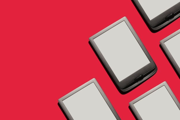 Ereader tablets screens on red background