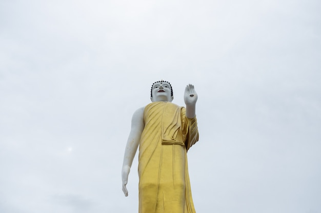 The erected buddha statue under clear sky in chiangmai,thailand.