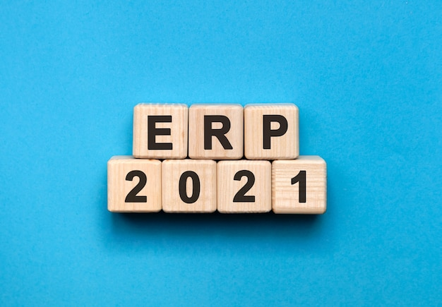 Erp - text concept on wooden cubes with gradient blue background.