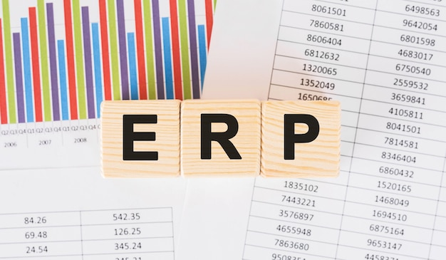 Erp word written on wood block. faqs text on table, concept.