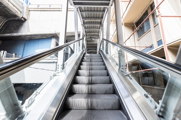 Escalator bts skytrain station is a public place,mechanical escalators for people up and down
