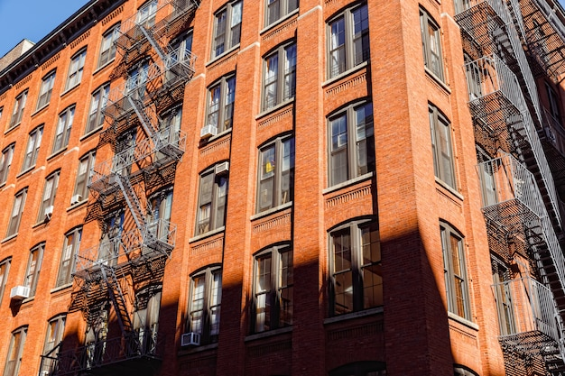 Escape fire ladders at house facades in dumbo, brooklyn