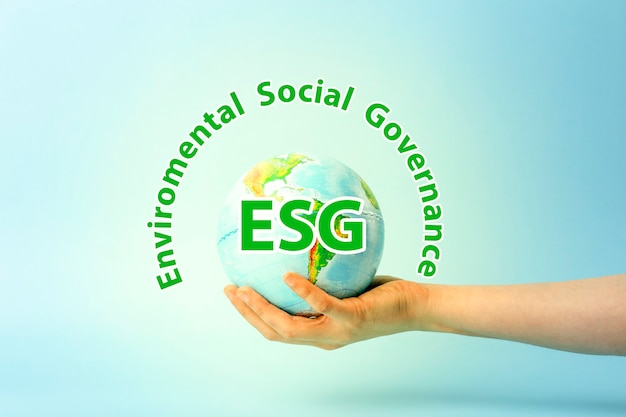 Esg modernization environmental social governance conservation and csr policy earth globe in hands o...
