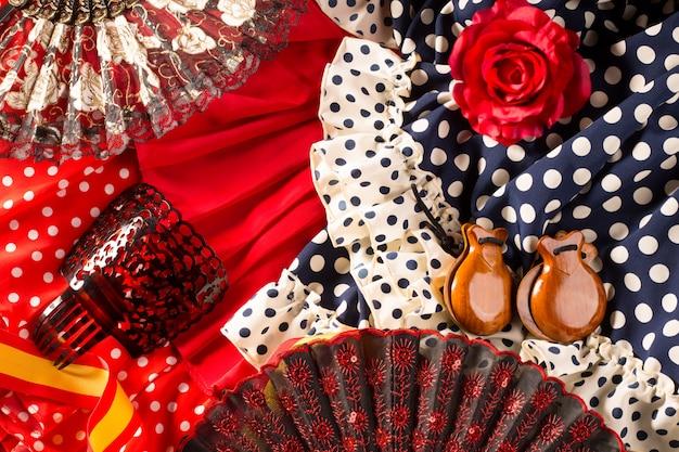 Испана типичная из испании с веером фламенко кастаньеты роза